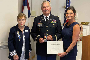 Retired Col. David Banner Jr., center, was recently recognized the Samuel Bacot Chapter of the Daughters of the American Revolution as the recipient of the chapter's 2021 Distinguished Citizen Award. Presenting Banner with a medal and certificate are Chap