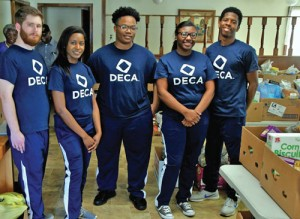 DECA assists church with food distribution