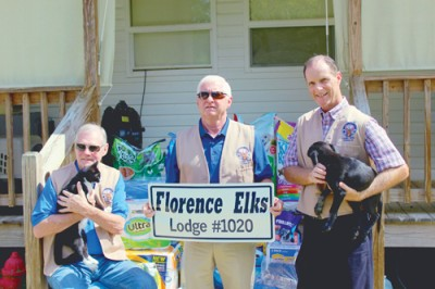From left Herman D. Cook, VP, Steven Schulman, President, and Mike Harrelson, V.P. The men are featured with their donation to the Darlington Humane Society.