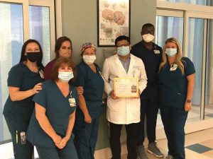 Dr Ravish Kothari, Medical Director of Stroke Services for McLeod Regional Medical Center is pictured with stroke team members from the McLeod Neuroscience Care Unit.