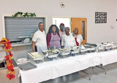 Knights of Pythias officers assist with meal