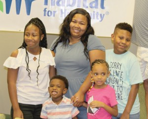 Family of five partners with Habitat for Humanity