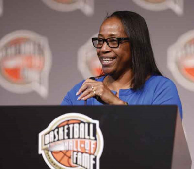 Pearl Moore laughs as she shares fond memories  during her Naismith  Basketball  Hall of Fame induction  speech on  Saturday.
