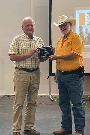 S.C. Cattleman's Association President Roscoe Kyle, right, presents John Rogers with a plaque recognizing him as the 2021 Cattleman of the Year.