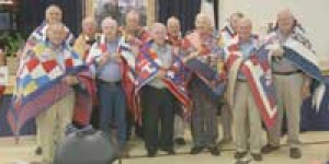 Service members from Central United Methodist share in a moment together after receiving their Quilt of Valor.