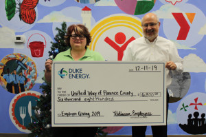 Plant presents check to United Way of Florence