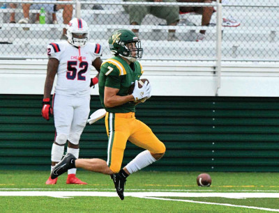 Wide receiver Jack Kitchens (7) hauls in a pass during West Florence's  35-14 victory over Cheraw on  Friday. It was the Knight's first game in their new $5 million stadium.  Photo by Steve Camlin